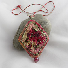 Claret pendant - hand-dyed, vintage lace and embroidery (Lynwoodcrafts) Tags: textilependant textilejewellery embroideredpendant lace vintagelace handdyedlace flowers pink green