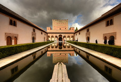 Court of the Myrtles (henriksundholm.com) Tags: courtofthemyrtles patiodelosarrayanes comarespalace court yeard patio alhambra comares palace pond water reflections shadows visitors people museum worldheritage architecture arabic medieval wideangle clouds cloudy sky hedge columns hdr granada spain espana andalucia andalusia