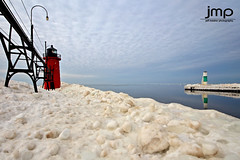 South Haven Lighthouse from the South Pier (Jeff Meeker) Tags: lakemichigan westmichigan winter winterwonderland weathered winterlife ice splash sparkle reflection reflections allthingsmichigan absolutemichigan artistic adventure slippery bluesky canon canont4i canondslr canon650d colorful clouds cloudsstormssunsetssunrises cold coldwater daylight day dangerousseas exploremichigan explore groupswithexperience interesting interestingness january 2017 lakeeffect michigan michigangottaluvit midwest michiganisamazing michiganlighthouses nature naturespaintbrush outdoorbeauty outdoorphotography outdoorphotographer outdoorphotos puremichigan photographersofwestmichigan peaceful quality southwestmichigan snow sunlight sunset stjosephmichigan stjoseph southhavenlighthouse southhaven southhavenpier thisisourmichigan themichigangallery theworldoutdoors vibrant texture newyearsadventures