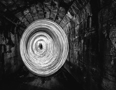 Into the Void (Ken Browne) Tags: abstract urban brickwork white swirls tunnel bridge monochrome dark blackandwhite lightpainting streetphotography