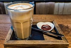 A Coconut Latte ( I Love Coffee Cafe) (High ISO) (Olympus OMD EM5II & M.Zuiko 12-100mm f4 Pro Travel-Zoom) (1 of 1) (markdbaynham) Tags: bruges brugge bruggen belgium city town historic famous urban metropolis olympus omd em5 em5ii csc evil mirrorless mft m43 micro43 micro43rd m43rd mzd mz zd mzuiko zuikolic 12100mm f4 pro travel zoom