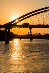 """Bridge Sunrise 1"" by Patti Deters (Patti Deters) Tags: bridge orange sun art water minnesota vertical truck sunrise canon river mississippi photography mono design office colorful traffic stock lobby transportation vehicle hastings copyspace mn interiordesign sillhouette cafeart hastingsbridge canon70d pattidetersphotography pattideters"