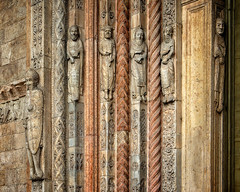 Sad bunch... (Tigra K) Tags: travel italy sculpture color church face it carving ornament verona veneto 2011 pattrn funorinterest architdetail