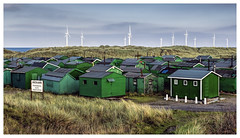Standing Out From the Crowd (Digital Wanderings) Tags: green huts teesside windfarm sheds redcar windturbines southgare fishermanshuts paddyshole fishermanshutsassociation