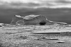 Black and White Arched Icebrg (jpmckenna - Tenquille Lake Up Next) Tags: snow ice antarctica iceberg petermannisland zodiaccruising