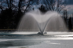 The frozen fountain (Anthony P26) Tags: category eskisehir kanlikavakpark landscape places travel turkey turkiye park citypark fountain water ice pond snow longexposure waterblur trees sky outdoor clouds greyclouds bluesky canon1585mm canon70d canon sunlight icy cold spray droplets winter winterscene wintry wow