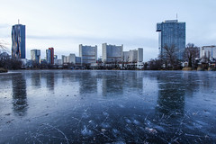 Winter Reflections (CoolMcFlash) Tags: city cityscape skyline winter frozen ice water altedonau river lake urban vienna austria modern building tower dc donaucity reflection canon eos 60d sigma 1020mm 35 stadt stadtlandschaft gefroren cold kalt eis wasser see flus städtisch unocity wien österreich gebäude hochhaus spiegelung reflektion reflexion fotografie photography kaisermühlen eislaufen