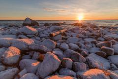 Emäsalo, Finland (tatianahelin) Tags: seashore winter stones sunset finland
