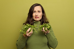 Gertrude grimacing at her greens wearing a green sweater standing against a green wall... (~ cynthiak ~) Tags: 365 365days 3652017 2017 february february2017 februarysalphabetfun februarysalphabetfun2017edition 38365 g theletterg green grimace greens odc ourdailychallenge health eatinggreens greensaregoodforyou img4688 selfportrait