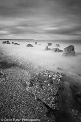 Reighton Rocks (David Relph) Tags: longexposure sea blackandwhite bw beach canon mono coast rocks northeast longshutterspeed reighton tamron1024mm davidrelph davidrelphphotography