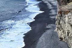 On the beach (halifaxlight) Tags: sea beach coast iceland surf waves cliffs figure southcoast dyrholaey