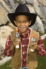 42-24172932 (MODELLEUS2) Tags: boy portrait people motion blur male face hat childhood smiling rock youth standing fun toy outdoors one costume outfit clothing holding hands toddler cowboy pattern child dress action coat small posing lifestyle happiness number attitude shirts jacket covered innocence imagination leisure daytime posture caring kindness cloth collar plaid cowboyhat halflength enjoyment makingfaces unbuttoned oneperson toygun selectivefocus grimacing individuality headgear rockformation facialexpression dressshirt outerwear lookingatcamera checkedpattern toyweapon africanethnicity africanamericanethnicity numeral6