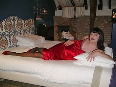 Relaxing (Paula Satijn) Tags: red hot sexy stockings girl bed pumps legs silk tgirl transvestite heels slip satin gurl silky nightgown nightdress nightie