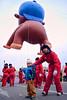 Holding a giant balloon