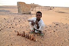 Souvenir Salesman (owilybug) Tags: pyramids nubian meroe sudan desert child portrait travel travelphotography canon canon5d wanderlust africa