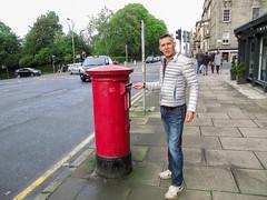 Sending a message (RIch-ART In PIXELS) Tags: edinburgh mailbox letterbox portrait scotland street road city town canon unitedkingdom schotland red man pavement park queenstreetgardens building