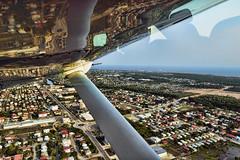39/52 - Strutting about (roijoy) Tags: reflection plane flying belize transport wing strut dsc9562