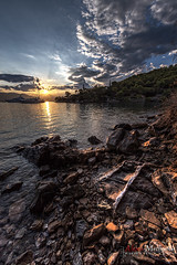 Harsh Sunset (Alexis Methenitis) Tags: blue sunset sea summer sky green water canon reflections rocks day hellas greece gr poros canonef14mmf28liiusm canoneos5dmkii eosdeurope