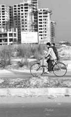 Joy ride (pathikdebmallik) Tags: road street bicycle locals child ride father cycle highrise rider kolkata calcutta joyride labourer streetphotographs rajarhat