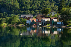~ A Little Piece of Norway ~ (Ranveig Marie Photography) Tags: visitnorway dirdal norge norway fjord sea reflection summer sommer gjesdal rogaland jæren fjell mountains dirdalsstranda frafjorden water sjø panorama houses boathouses naust nøst sjøhus spegling speiling bluesky blueskies seascape coast shore forest woods trees trær skog green blue colours colorful colourful norvege norwegen noruega ranveignesse ranveigmarienesse images pics photos pictures norsk natur nature sunshine pano photographs paysage colors buoy explore explored norwegian norvège bilder photography still fjords wald stillhet symmetry symmetri symmetric symmetrisk