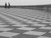 stopping for a chat (Cosimo Matteini) Tags: cosimomatteini ep5 olympus pen m43 mft mzuiko45mmf18 livorno leghorn terrazzamascagni people cyclist tiles pavement blackandwhite bw stoppingforachat