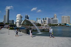 Merlion by the bay in Singapore (UweBKK (α 77 on )) Tags: singapore southeast asia city state island urban sony alpha 77 slt dslr merlion tourist attraction landmark famous bay sky clouds blue water skyline cityscape