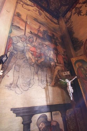 Naigrawanie i św. Roch na północnej ścianie przy łuku tęczowym w kościele w Boguszycach