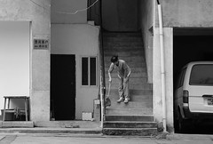 Paradise Lost (Andy WXx2009) Tags: blackandwhite outdoors cars people urban stairs brush sweeping doorway guillin china asia asiangirls streetphotography candid monochrome artistic building woman city garage