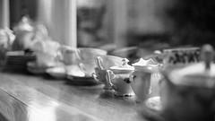 Standing in line - cups (BasWindfotografie) Tags: old light blackandwhite bw classic closeup composition contrast analog canon 50mm evening zwartwit bokeh f14 scene spot explore nostalgia nostalgic analogue canonae1 popular 400asa metering spotmetering ambiance editors trix400 editorschoice oldambt canonfd50mmf14 winschoten analoog scène manuallens oldgear absenceofcolour tobeexplored