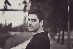 Alex (Raquel Malln) Tags: street old trees friends boy portrait people bw sunlight black texture alex valencia face hair beard 50mm back eyes friend looking friendship gente natural random bokeh expression young handsome days his urbano confident