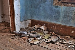 Sensible shoes? (slammerking) Tags: house texture abandoned shoes decay brokenglass creepy forgotten kansas walls left woodgrain weatherd baseboards rurex