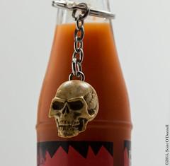 Hot Sauce (scottnj) Tags: red macro skull keychain condiment tabasco hotsauce tobascosauce scottnj scottodonnellphotography