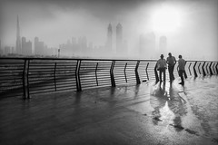 Foggy Mornings (Madhusudanan Parthasarathy) Tags: foggymorning winter fog mist people walking dubai dubaiwatercanal uae middleeast gulf blackandwhite burjkhalifa shadows highlights streetphotography madhusudananparthasarathy nikon d750