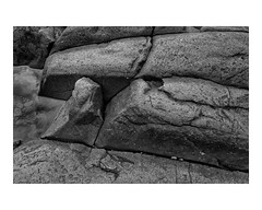 Basalt along Lake Superior (Richard C. Johnson: AKA fishwrapcomix) Tags: leicaq summilux28mm f17 digital duluth basalt canadianshield lakesuperior blackandwhite bw monochrome rocks nature stone water minnesota greatlake reflections pebbles fckirony duluthgabbro duluthcomplex