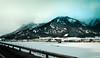 Mountain Highway (dorianborovac) Tags: austria alps mountain hills snow winter outdoor nature landscape highway road roadtrip nikon d5100 fence town village trees
