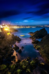 Bay in Sao Roque (MaciejJanowskiphoto) Tags: ifttt 500px boat longexposure long exposure water ocean sea mountains island city night bay rocks light azores portugal blue moss blur clouds sky nightscape nightsky dusk hour twilight motion canon photography