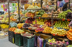 Fruit stall in a Guanajuato market, (Rob Huntley Photography - Ottawa, Ontario, Canada) Tags: fruit booth mexico photography photo display market indoors photograph guanajuato mx seller fruitseller indoormarket robhuntley
