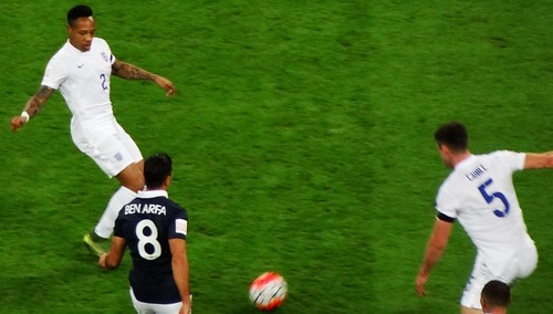 Nathaniel Clyne slipping a pass to Gary Cahill in front of France's Hatem Ben Arfa