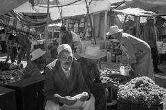 Morning at the Market (toletoletole (www.levold.de/photosphere)) Tags: street portrait people bw man market portrt morocco grapes sw vendor mann marrakesh markt marokko marrakesch weintrauben hndler xt1 fujixt1