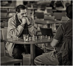 Concentration (sorrellbruce) Tags: bw mall concentration fuji chess games cafeteria strategy iso1600 patience skill opponents lr6 photoninja framefun fujinon90mm fujixt1