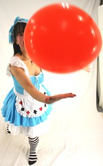Catch A Gift From Cutie Cards Queen (emotiroi auranaut) Tags: cute adorable girl woman lady toss catch gift surprise dress socks play playing playful fun clever big orange toy balloon mischief mischievous