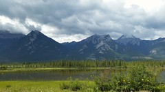 Jasper National Park Roadside (Patricia Henschen) Tags: jaspernationalpark jasper alberta canada canadian rockies mountains northern rocky transcanadahighway muskeg athlabascariver clouds cloudy lake river mountain