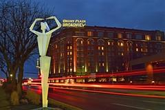 Peerless Princess of the Prarie (slammerking) Tags: wichitaks statue bluehour lighttrails taillights downtown douglas hotel broadview sculpture art dusk twilight traffic druryplaza