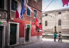 All flags out! Communist party office, Venice (Tigra K) Tags: venice veneto italy it 2014 city color fabric flag road ruin vine wall