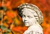 Weather-worn sculpture (Keith in Exeter) Tags: sculpture garden weathered worn ornamental depthoffield nationaltrust knightshayescourt tiverton devon england uk outdoor face hat bonnet