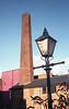 FILM - Gas lamp and smokestack (fishyfish_arcade) Tags: agfavistaplus200 analogphotography filmphotography filmisnotdead istillshootfilm olympustrip35 analogcamera film poundlandagfa gaslamp chimney chimneystack smokestack