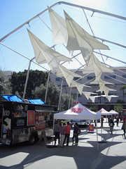 Flying Over the Taco Trucks at Grand Park (Robb Wilson) Tags: freephotos grandpark downtownla losangeles tacotrucks giantpaperairplanes shadowsandlight