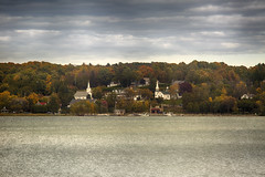 Ephraim, Wisconsin, Fall (mckenziemedia) Tags: county door city autumn trees fall church water wisconsin clouds canon landscape eos bay town mark iii steeple 5d ephraim quaint ef 100300mm