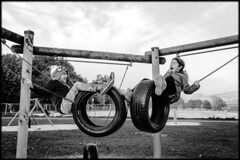 On the swings (Michael Wögerbauer) Tags: leicam9 summicron35asph blackandwhite blackwhite schwarzweiss schwarzweis noiretblanc streetphotography children playingonthestreets