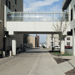 Silly-looking thing: a skywalk/skyway. (Tim Kiser) Tags: 17thstreet 2010 20100412 april april2010 img4087 illinois moline molineillinois molinerockisland quadcities quadcitiesmetropolitanarea rockislandcounty rockislandcountyillinois rockislandmoline alley backalley bridge downtown downtownmoline elevatedstructure elevatedwalkway northillinois northernillinois northwestillinois northwesternillinois parkingrampskywalk parkingrampskyway partlysunny paved pavement pedestrianbridge pedestrianfacility pedestrianwalkway skywalk skyway sunroom westillinois westernillinois unitedstates